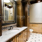 Bathroom With Marble Tiled Walls And Dark Wood Cabinets Stock Photo Download Image Now Istock