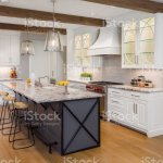 Beautiful Kitchen In New Luxury Home With Island Pendant Lights And Glass Fronted Cabinets Foto De Stock Y Mas Banco De Imagenes De Acero Inoxidable Istock