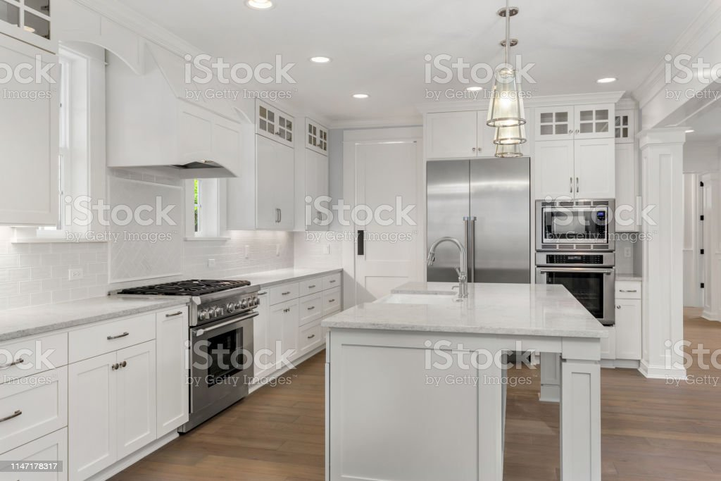 Beautiful White Kitchen In New Luxury Home With Island ... on Luxury Farmhouse Kitchen  id=47394
