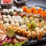 Foto De Big Plate With Various Sushi Uramaki And Sashimi E Mais Fotos De Stock De Alimentos Defumados Istock