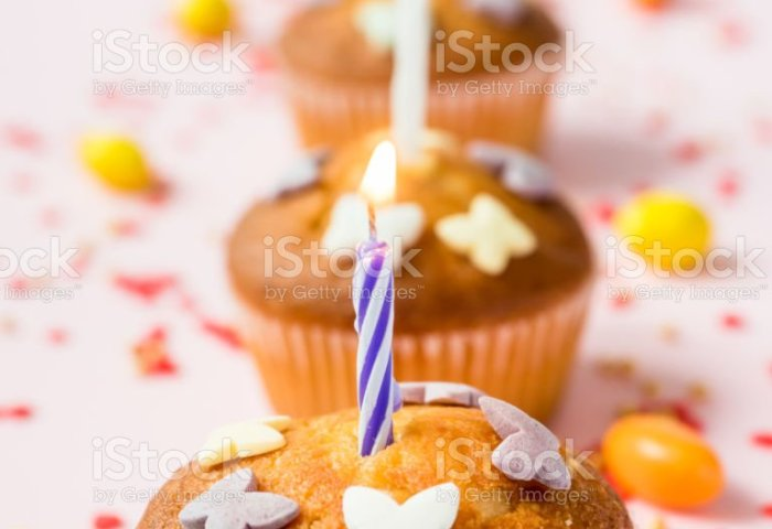 Birthday Cupcakes With Candles On The Table Pink Background Stock