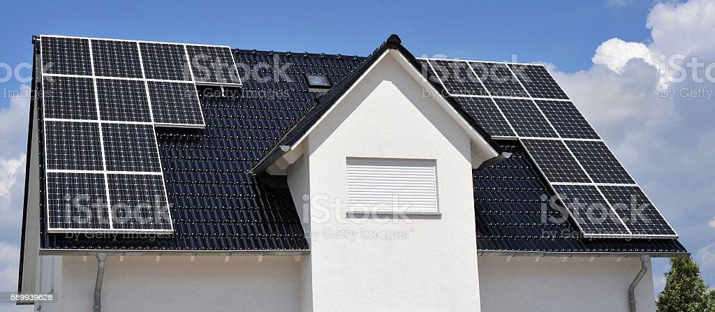 https www istockphoto com photo black tile roof with solar panels gm589939628 101312949