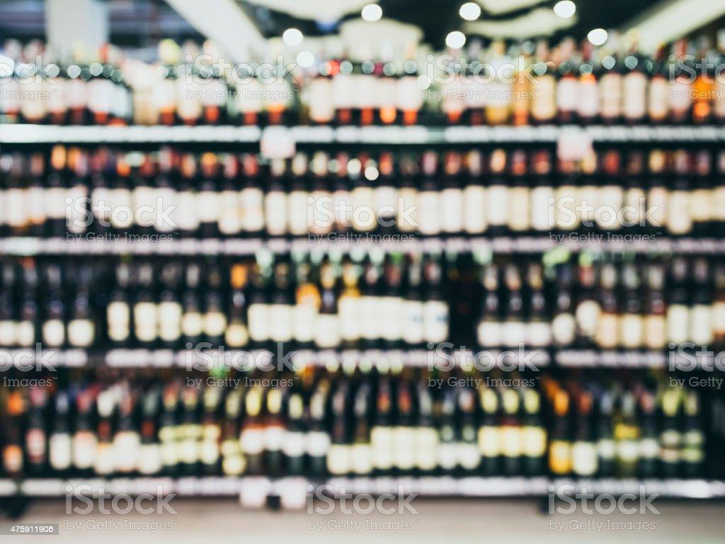 Blurred Wine Liquor Bottle On Shelf Retail Store Background