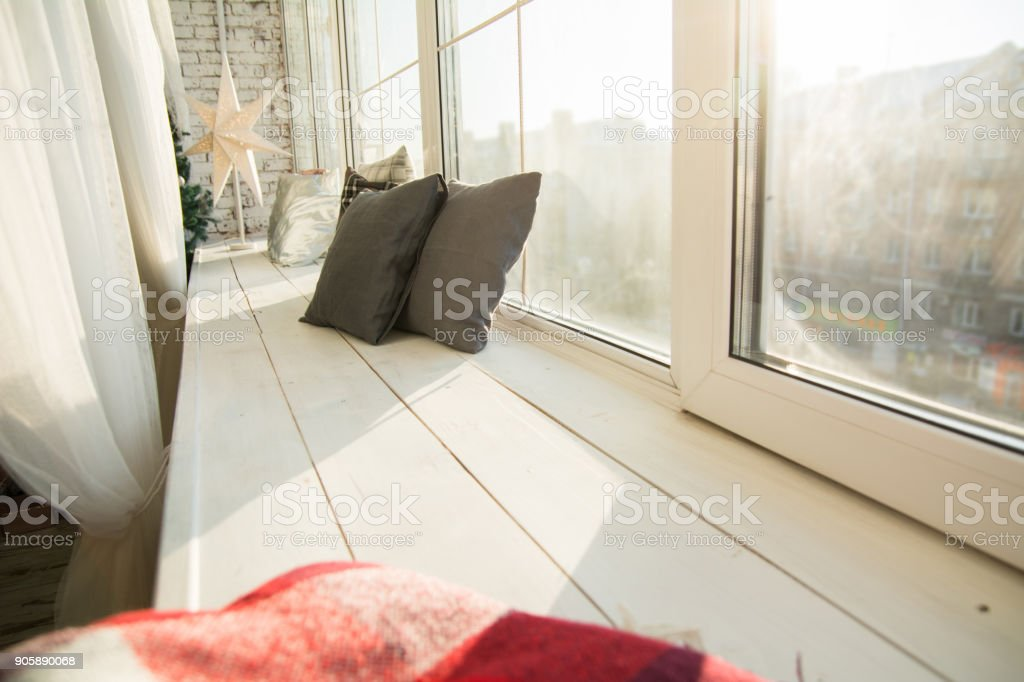 https www istockphoto com photo brown cushions on a wooden window sill gm905890068 249775791