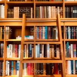 Brown Wooden Shelfs Fully Packed With Books In A Library