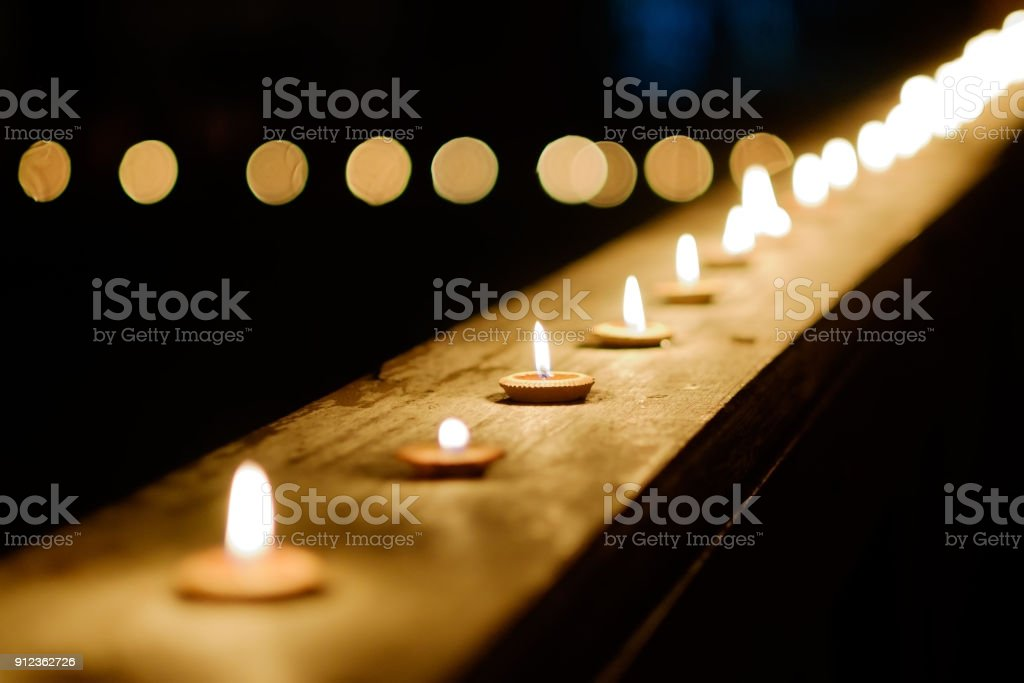 https www istockphoto com photo burning candles in thai style candle light in row at night time during loy krathong gm912362726 251173858