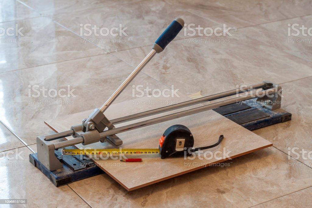 https www istockphoto com photo ceramic tiles and tools for tiler floor tiles installation home improvement gm1096815104 294501489