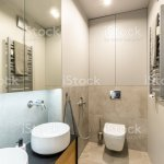 Ceramic Washbasins And Toilet In A Modern Fancy Bathroom Interior With Beige Marble Tiles And Wooden Furniture Stock Photo Download Image Now Istock