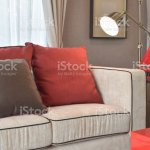 Classic Industrial Look Living Room With Beige Sofa And Red And Deep Brown Linen Pillows With Brass Reading Lamp Stock Photo Download Image Now Istock