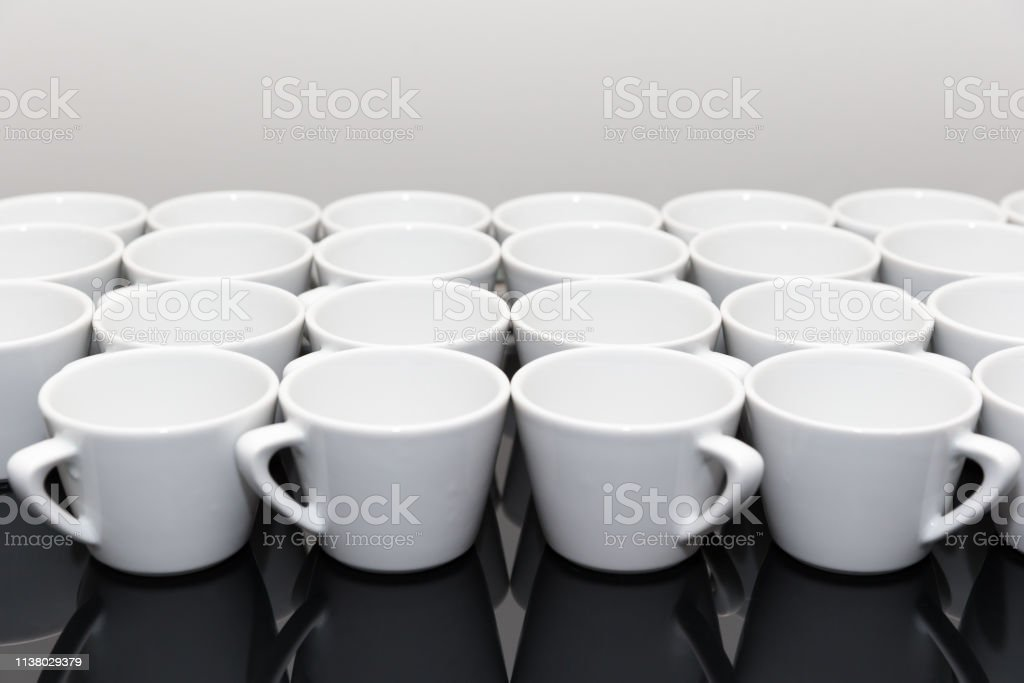 https www istockphoto com photo coffee cups stacked on the shelf gm1138029379 303673067