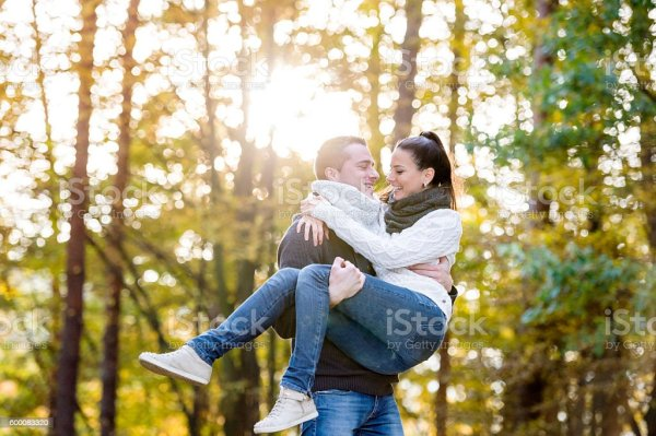 Couple In Love Man Carrying Woman In His Arms Stock Photo ...