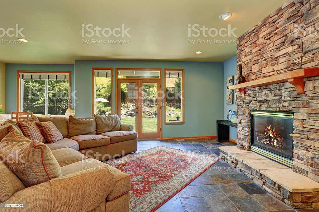 https www istockphoto com photo cozy living room with blue walls and stone tile fireplace gm587890202 100934485