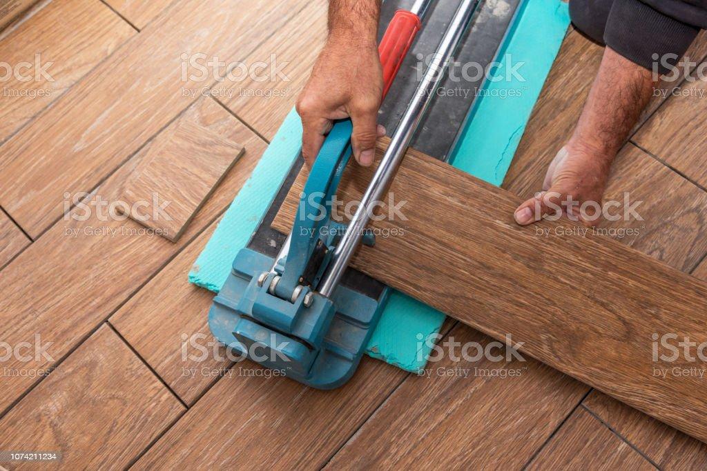 https www istockphoto com photo cutting ceramic tiles gm1074211234 287603353