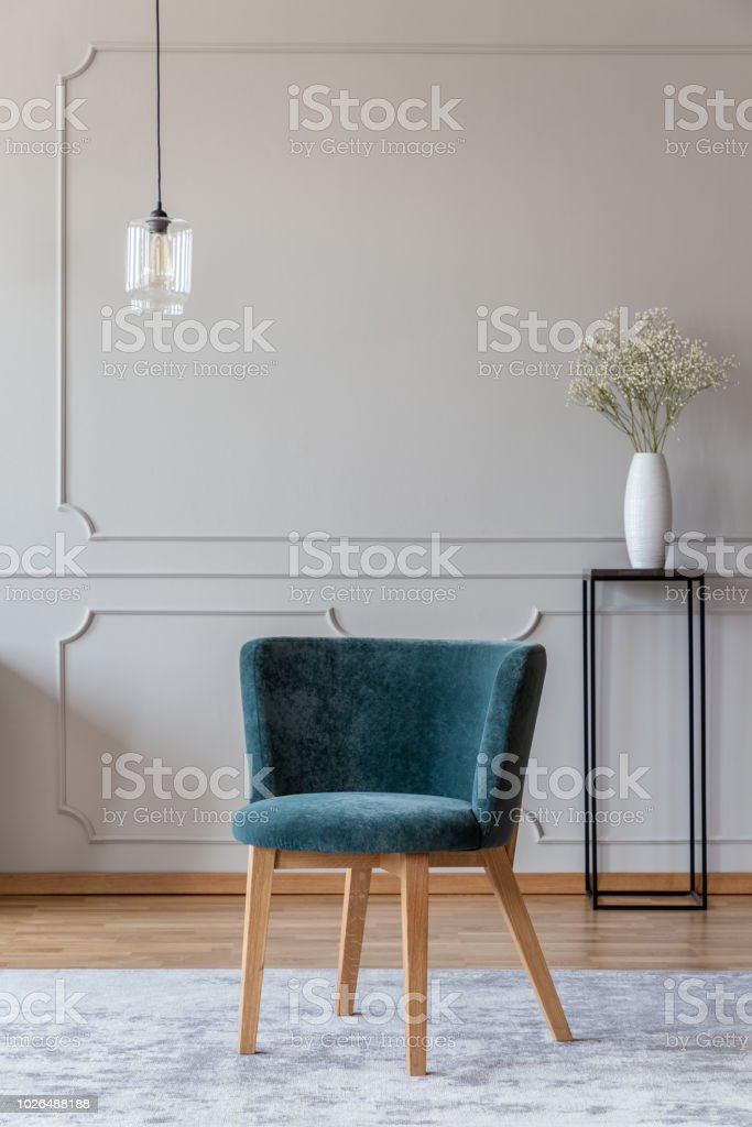 Emerald Green Chair With Wooden Legs On A Gray Rug In A Stylish Living Room Interior With Molding On Beige Walls Stock Photo Download Image Now Istock
