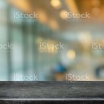 Empty Black Marble Stone Table Top And Blurred Coffee Shop And Restaurant Interior Background Can Used For Display Or Montage Your Products Stock Photo Download Image Now Istock