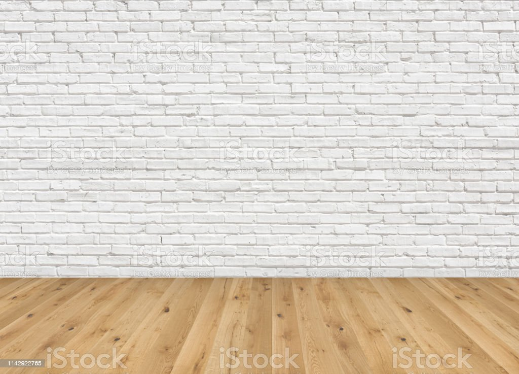 empty room with brown ash wood floor and old white painted brick wall empty loft room for design interior stock photo download image now istock