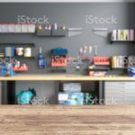 Empty Wooden Table Top With Blur Garage Interior Stock Photo Download Image Now Istock