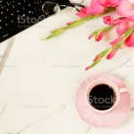 Flat Lay Womens Office Desk Female Workspace With Laptop Flowers Pink Gladioluses Accessories Glasses Cup Of Coffee On Marble Desk Background Stock Photo Download Image Now Istock