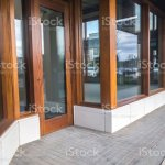 Front Doors For A Business Still Under Construction And Locked With A Padlock Key In A Shopping Complex Stock Photo Download Image Now Istock