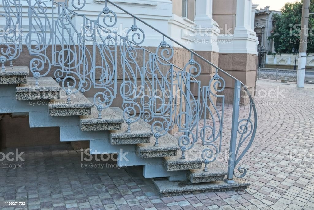 Gray Concrete Steps And Iron Handrails With A Forged Pattern On   Handrails For Concrete Steps   Deck Stair   Ada   Wood   7 Hand   Concrete Entrance