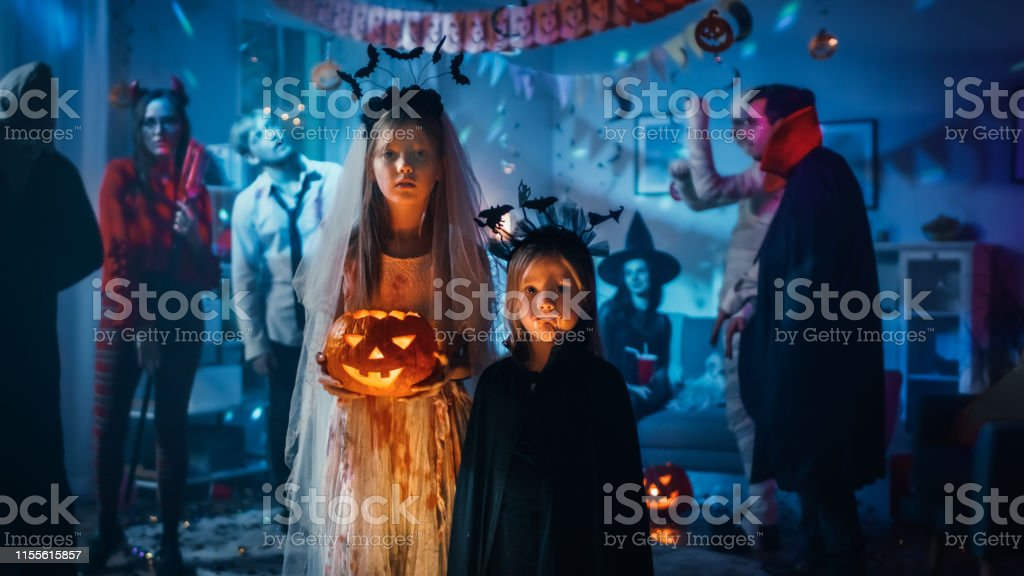 Every item on this page was chosen by a woman's day editor. Halloween Costume Partyportrait Girl In A Bloody White Bride Dress Holding Scary Doll Standing With Cute