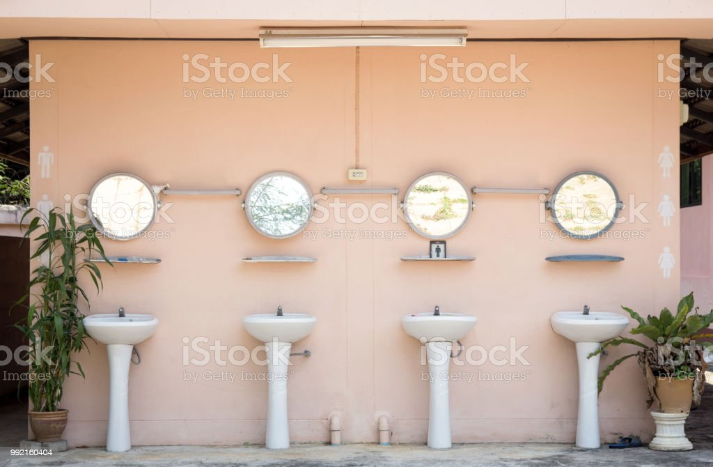 https www istockphoto com photo hand washing basin in public toilet gm992160404 268841170
