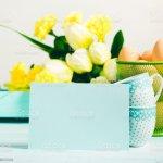 Happy Easter Pastel Green Yellow Background Tulips Card Foto De Stock Y Mas Banco De Imagenes De Amarillo Color Istock