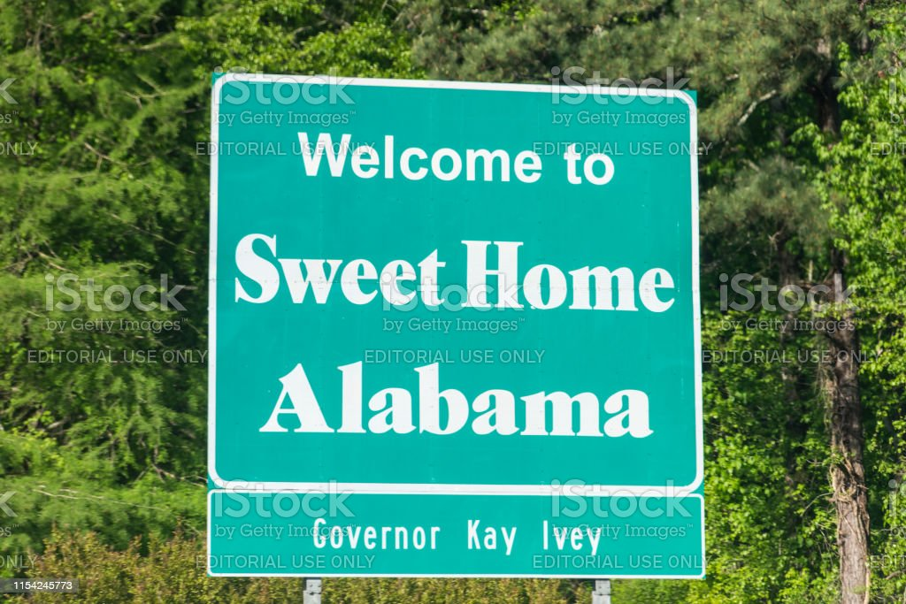 """""""sweet home, alabama"""" means that the state of alabama (in the usa) where somebody's home is, is a nice place, a place that is sweet like honey or sugar. Highway Road In Alabama With Welcome Sign And Text On Street With Nobody And Sweet Home Text With Governor Kay Ivey Stock Photo Download Image Now Istock"""