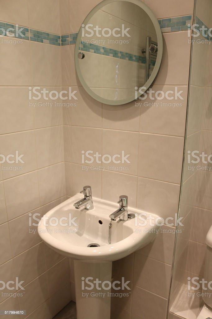 https www istockphoto com photo image of pedestal sink circular mirror modern white tiled bathroom gm517994670 89771289