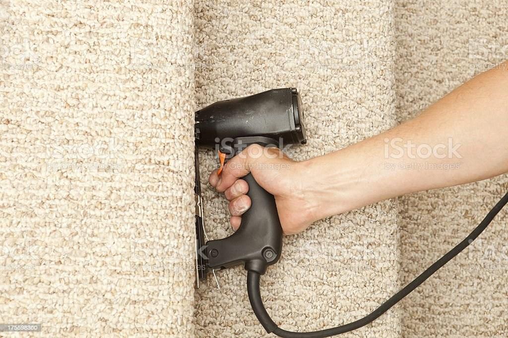 Installer Stapling New Stair Carpet Stock Photo Download Image | Stapling Carpet To Stairs | Electric Stapler | Flooring | Stair Tread | Landing | Stair Runner