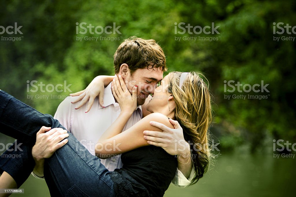 Man Holding Woman Romantically In Arms Stock Photo ...