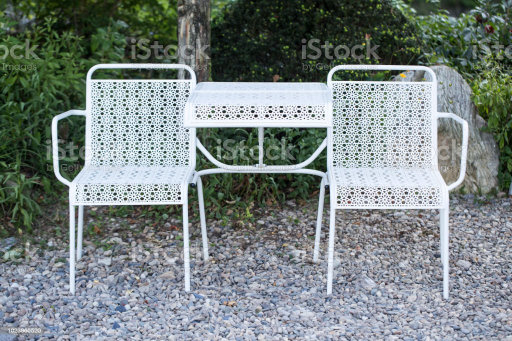 metal patio furniture with sets of empty tables and chairs stock photo download image now istock