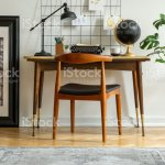 Midcentury Modern Chair With Leather Seat By A Desk With An Industrial Lamp And A Retro Typewriter In A White Home Office Interior Stock Photo Download Image Now Istock
