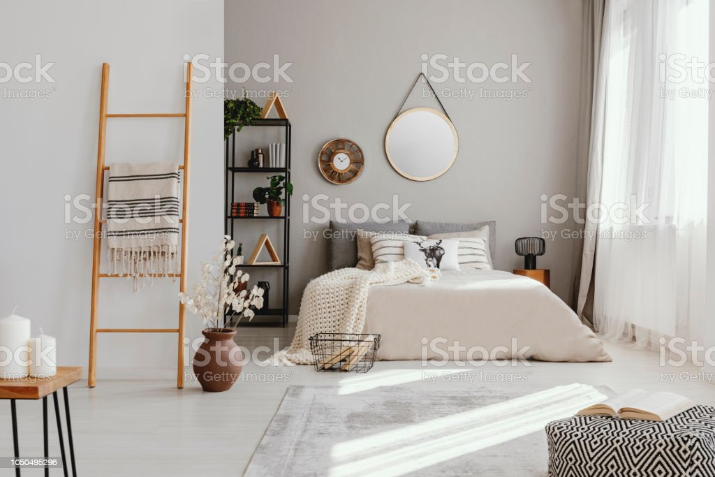 Mirror And Clock Above Bed In Bright Bedroom Interior With ... on Mirrors Next To Bed  id=70049