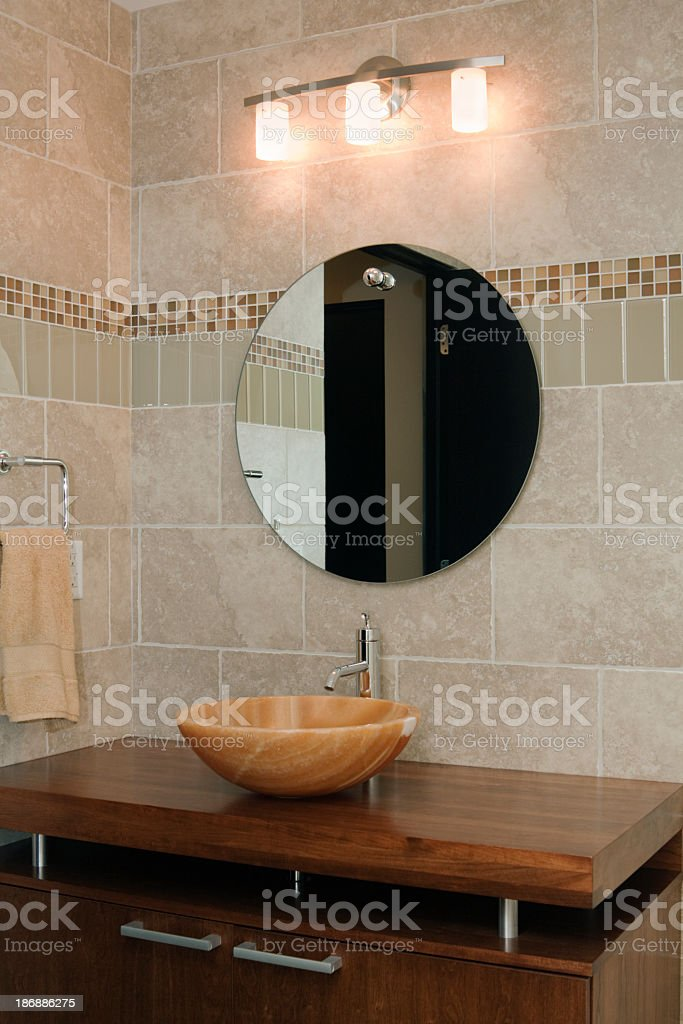 https www istockphoto com photo modern bathroom tiled interior with vanity mirror sink cabinet lighting gm186886275 11195881