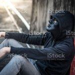 Mystery Man In Black Mask Sitting In Abandoned Building Feeling Exhausted Stock Photo Download Image Now Istock
