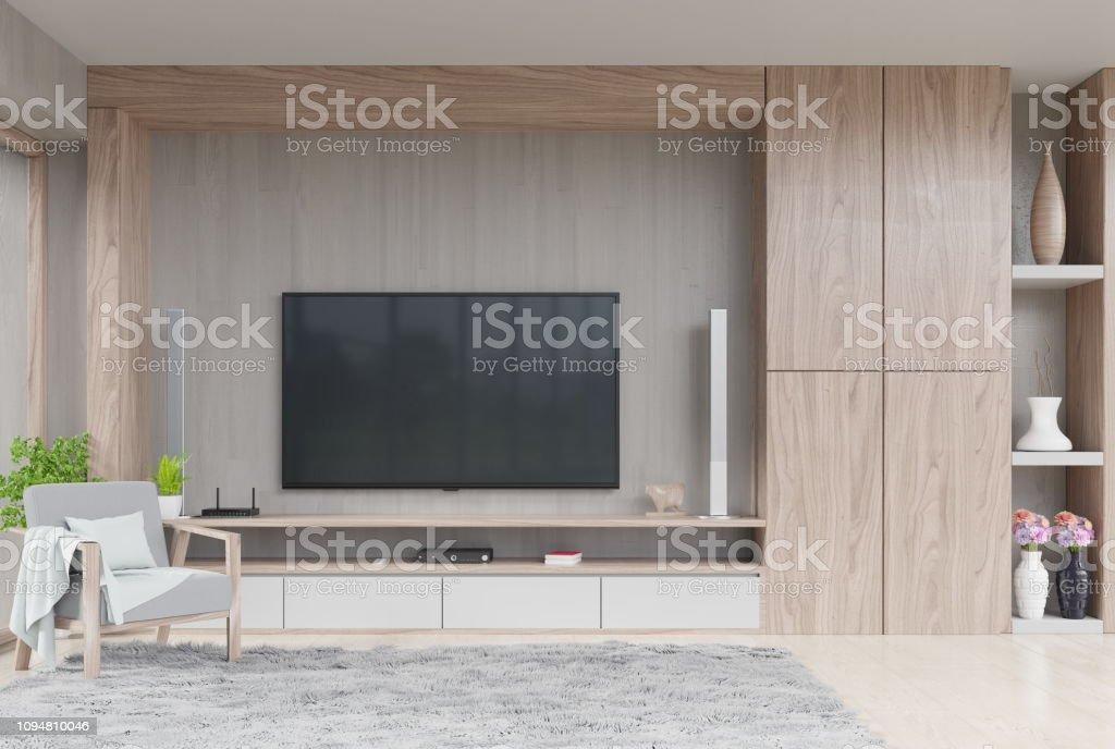 https www istockphoto com fr photo tv sur mur de salon moderne avec d c3 a9coration et fauteuil gm1094810046 293849145