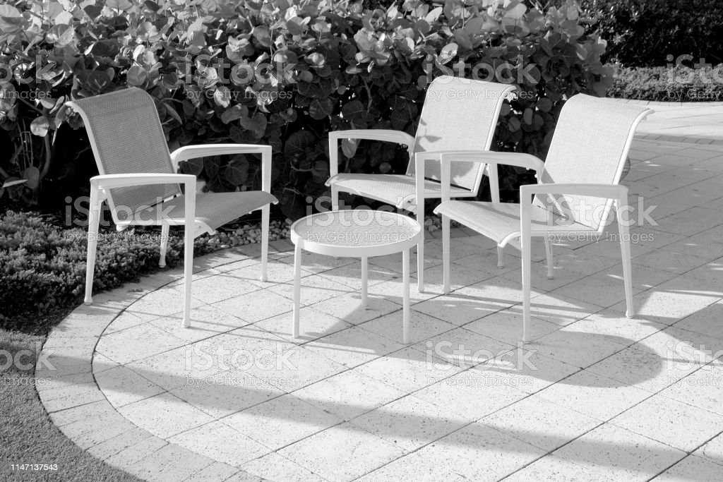 https www istockphoto com photo patio furniture captured in black and white gm1147137543 309336172