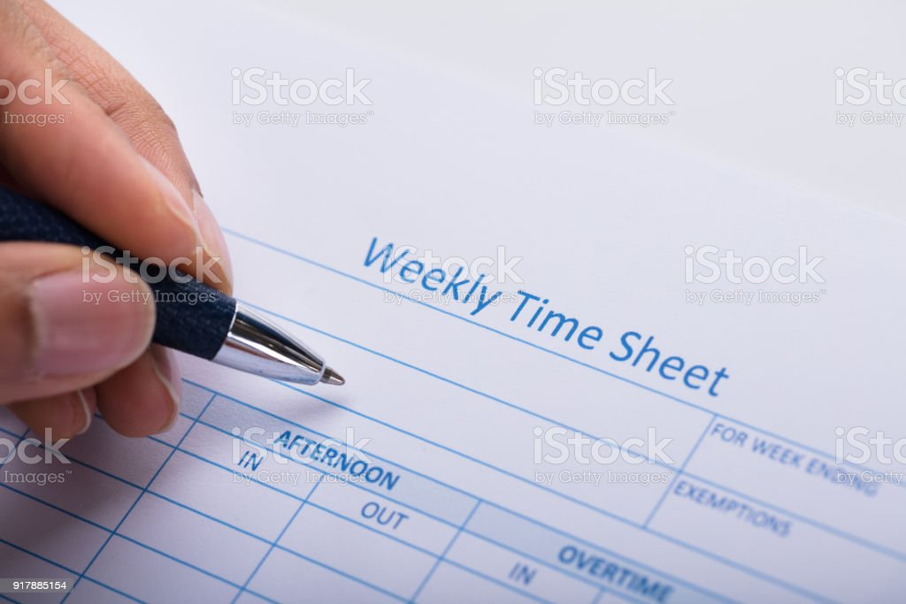 Person Filling Weekly Time Sheet With Pen Stock Photo   More     Person Filling Weekly Time Sheet With Pen royalty free stock photo