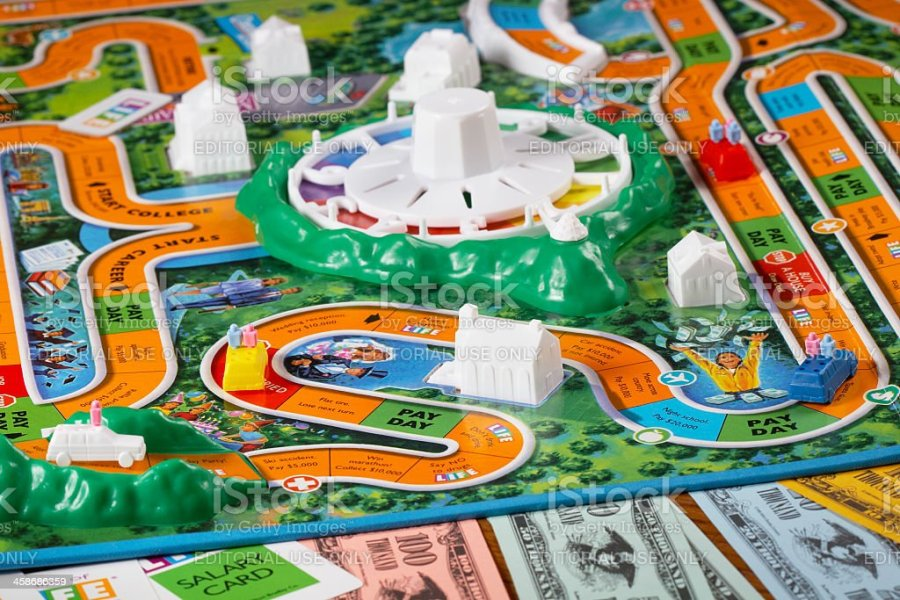 Royalty Free Game Of Life Board Game Pictures  Images and Stock     Playing The Game of Life stock photo