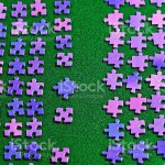 Purple Puzzle Pieces Sorted On A Green Table Cloth Stock Photo Download Image Now Istock
