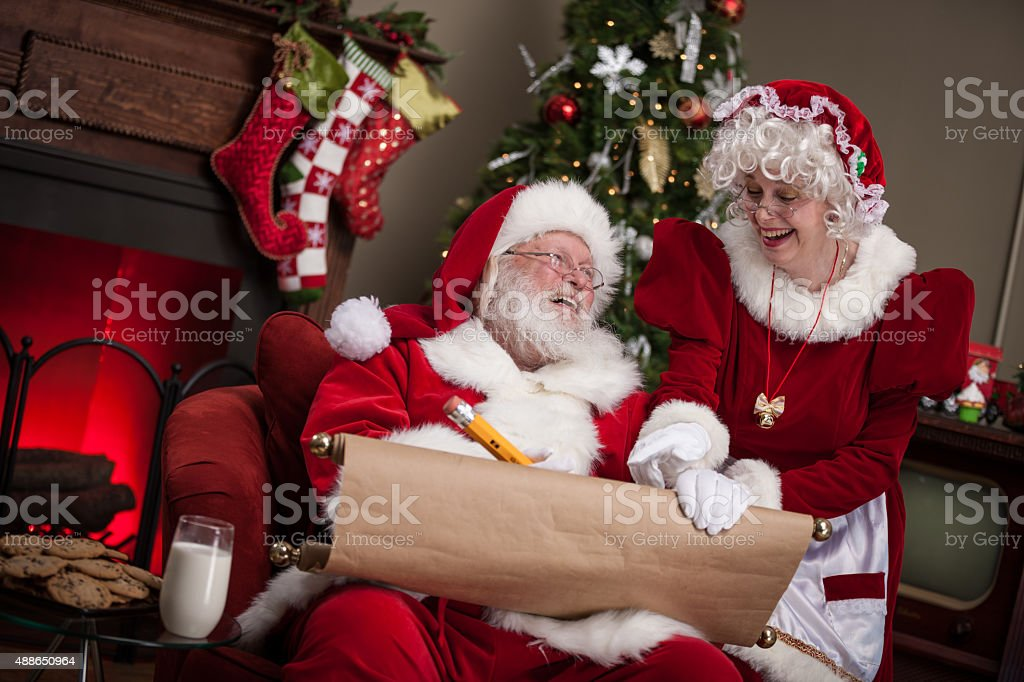 Santa Claus And Wife Working On Naughty And Nice List ...