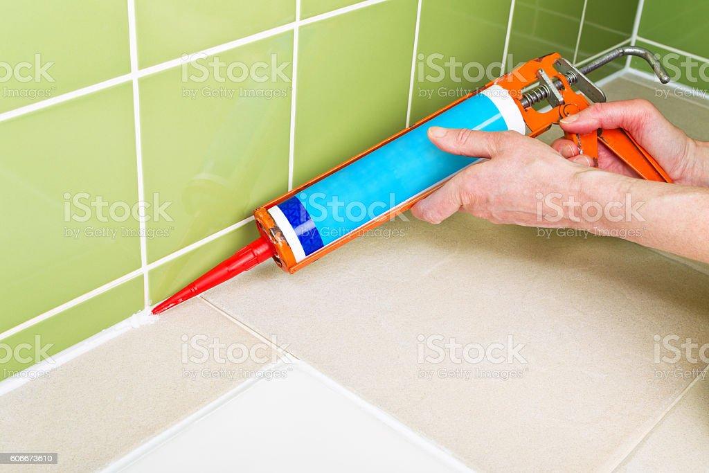 https www istockphoto com photo sealing shower tiles with caulk gun gm606673610 103998829