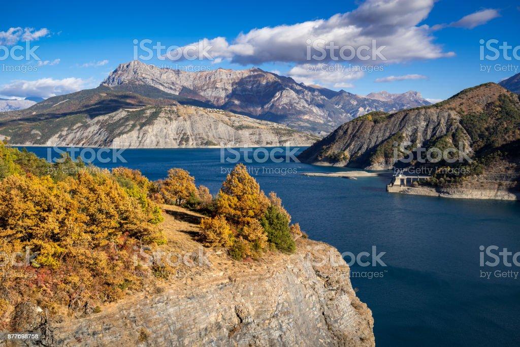 https www istockphoto com photo serre poncon lake in autumn hautes alpes alps france gm877698758 244867960
