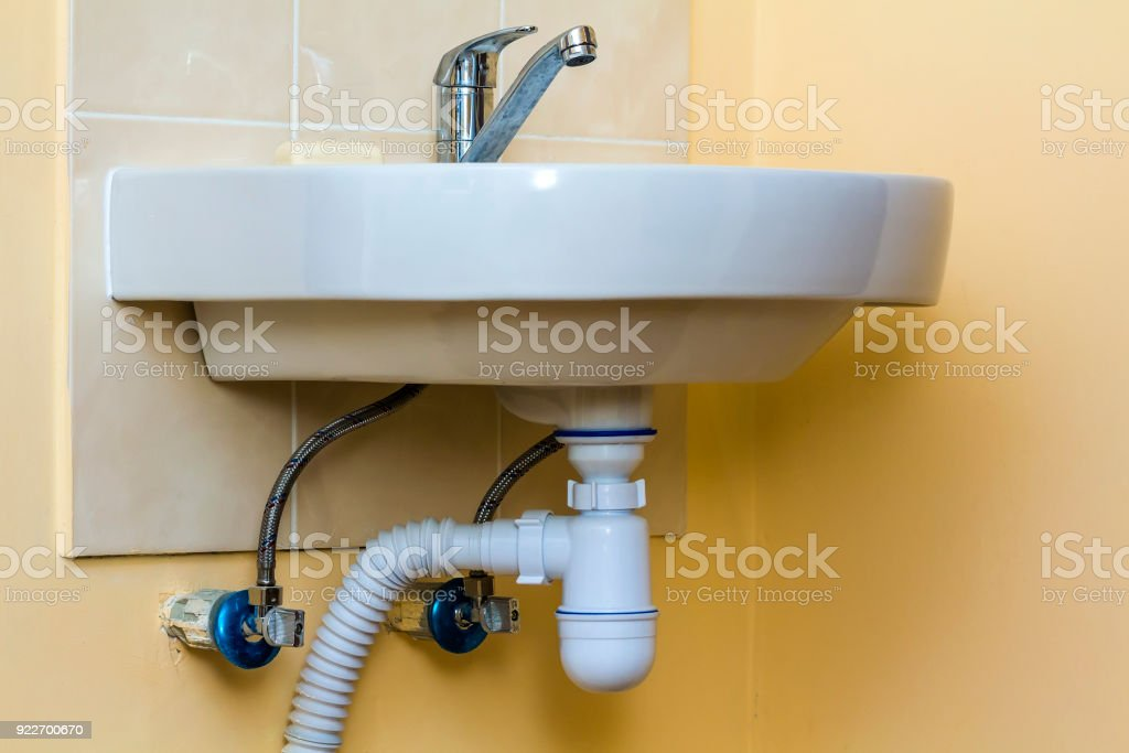 sewer drain pipes under the kitchen sinkplumbing fixture and faucets stock photo download image now istock