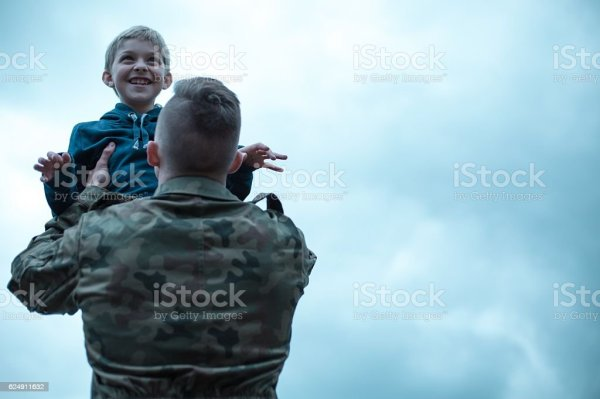 Soldier With His Son In His Arms Stock Photo - Download ...