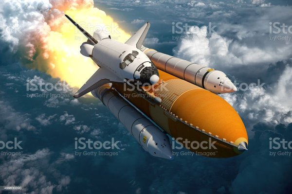 Space Shuttle Flying Over The Clouds Stock Photo ...