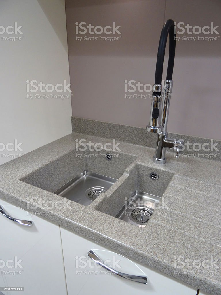 https www istockphoto com photo stainless steel kitchen sink single basin composite laminate corian grey worktop gm523786989 51677896