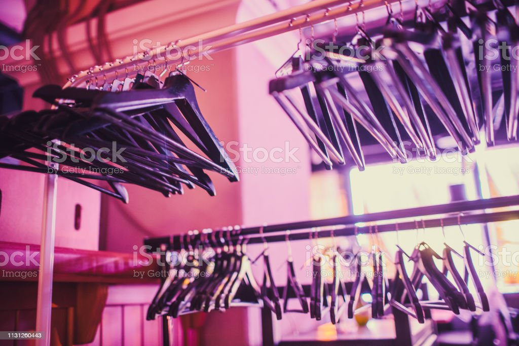 https www istockphoto com photo stock of empty clothes hanger in wardrobe wooden coat hangers hanging on a cloth gm1131260443 299483924