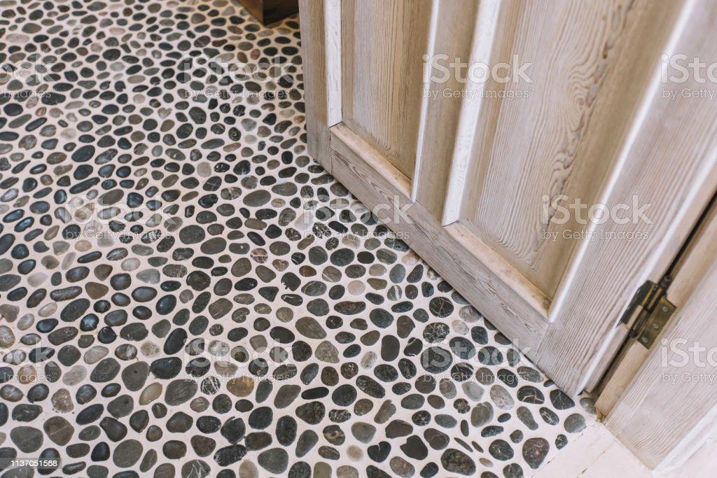 stone tile floor and wood door stock photo download image now istock